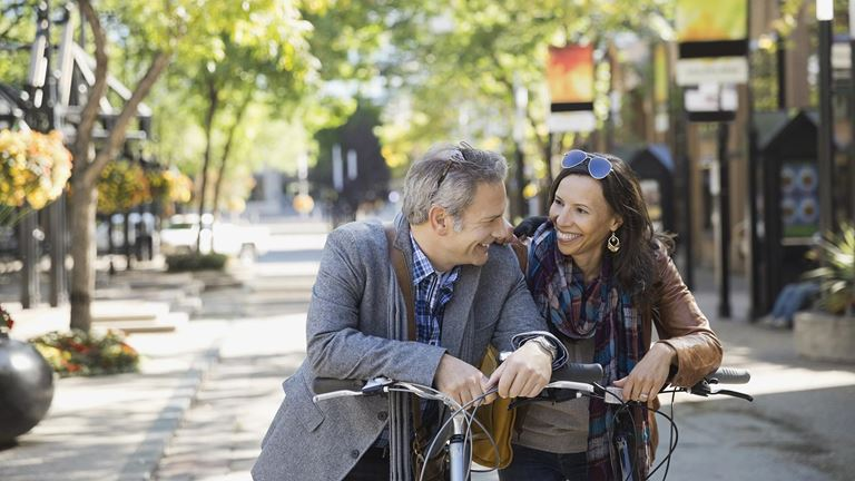 Smiling couple discussing personal money management