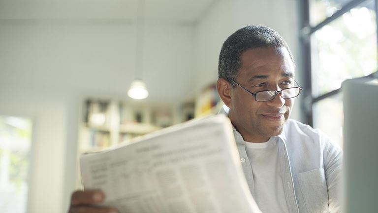 Man reading recent UW Credit Union news online