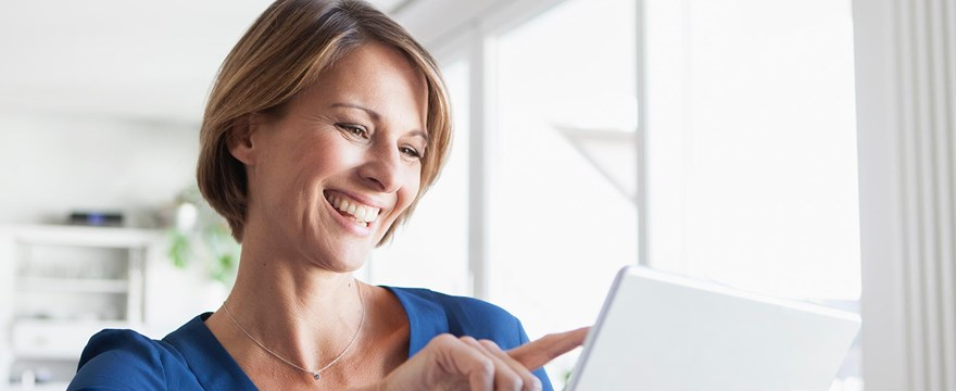 Woman researches retirement accounts on a tablet