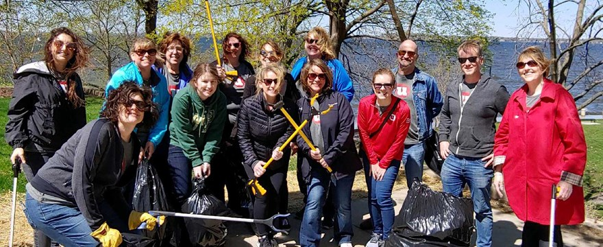 UW Credit Union employees volunteer on Earth day to clean up Madison park.